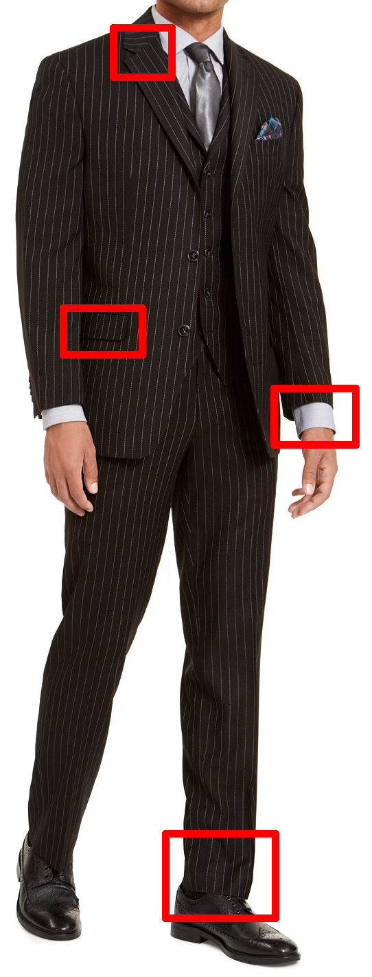 The stripes on the lapels and jacket pocket do not line up here. The suit is also too short for the model: the jacket sleeves expose too much of his shirt cuffs, and the trousers do not break at all across his shoes.