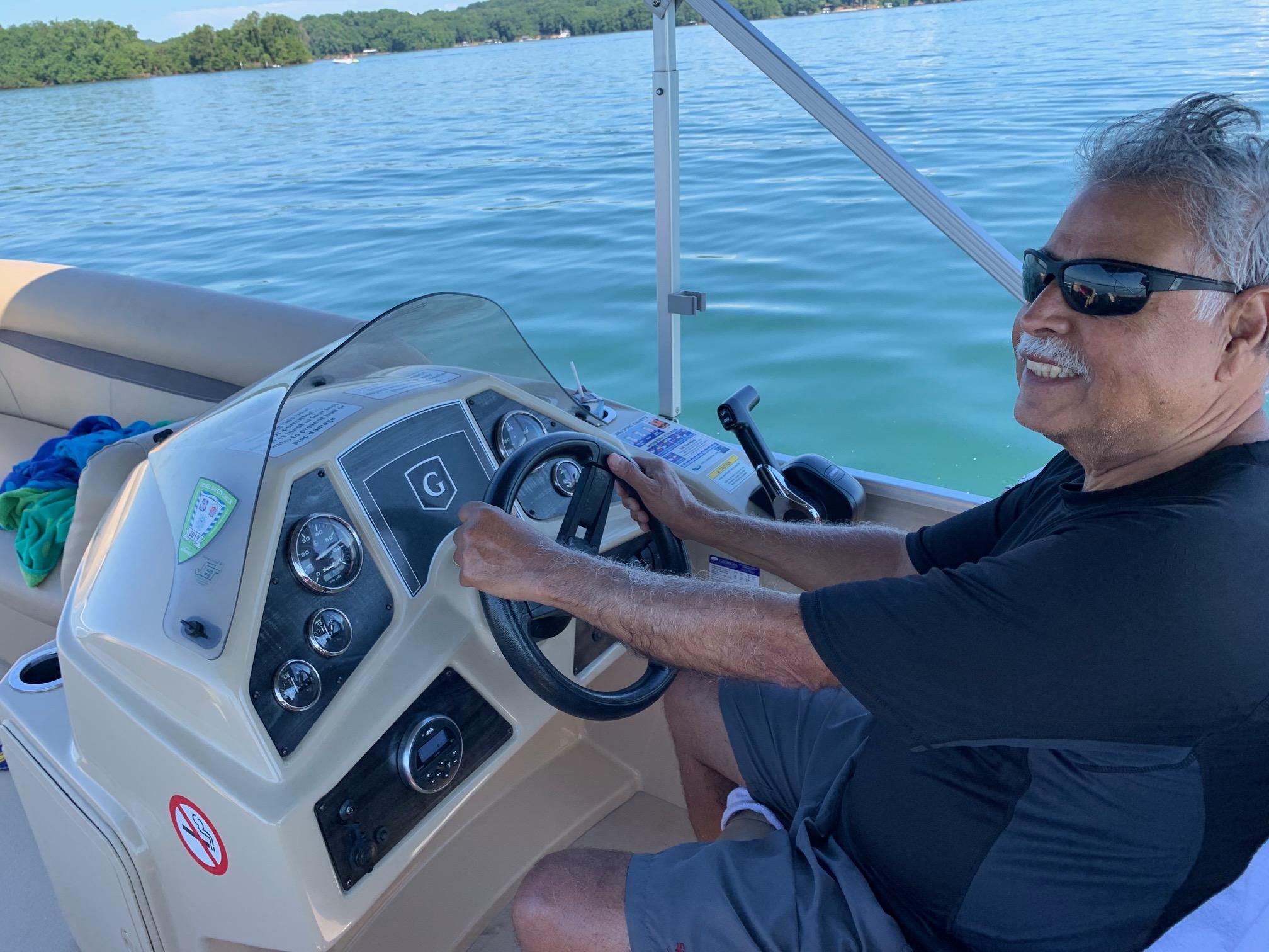 Ken driving pontoon on Lake Lanier
